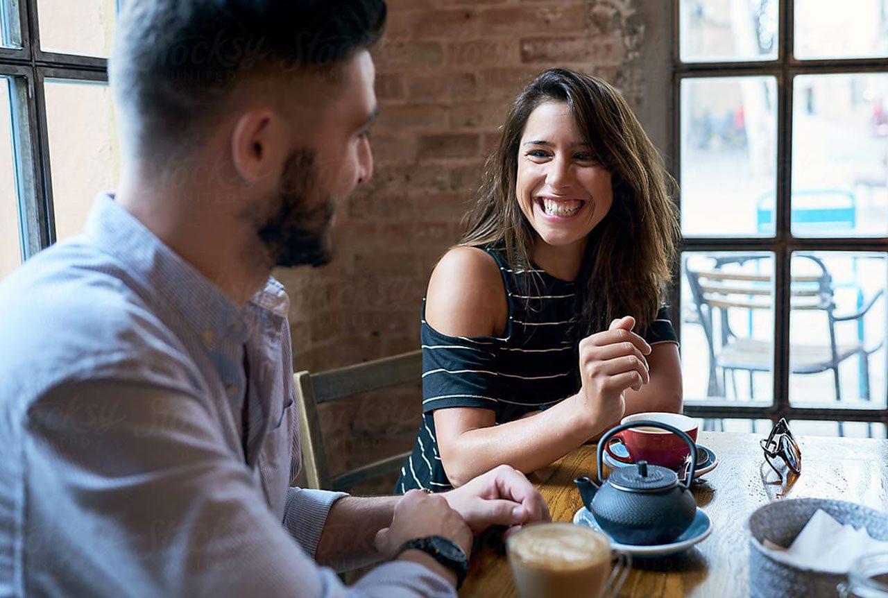 The Marke Apartments Elmhurst Man and Woman having coffee