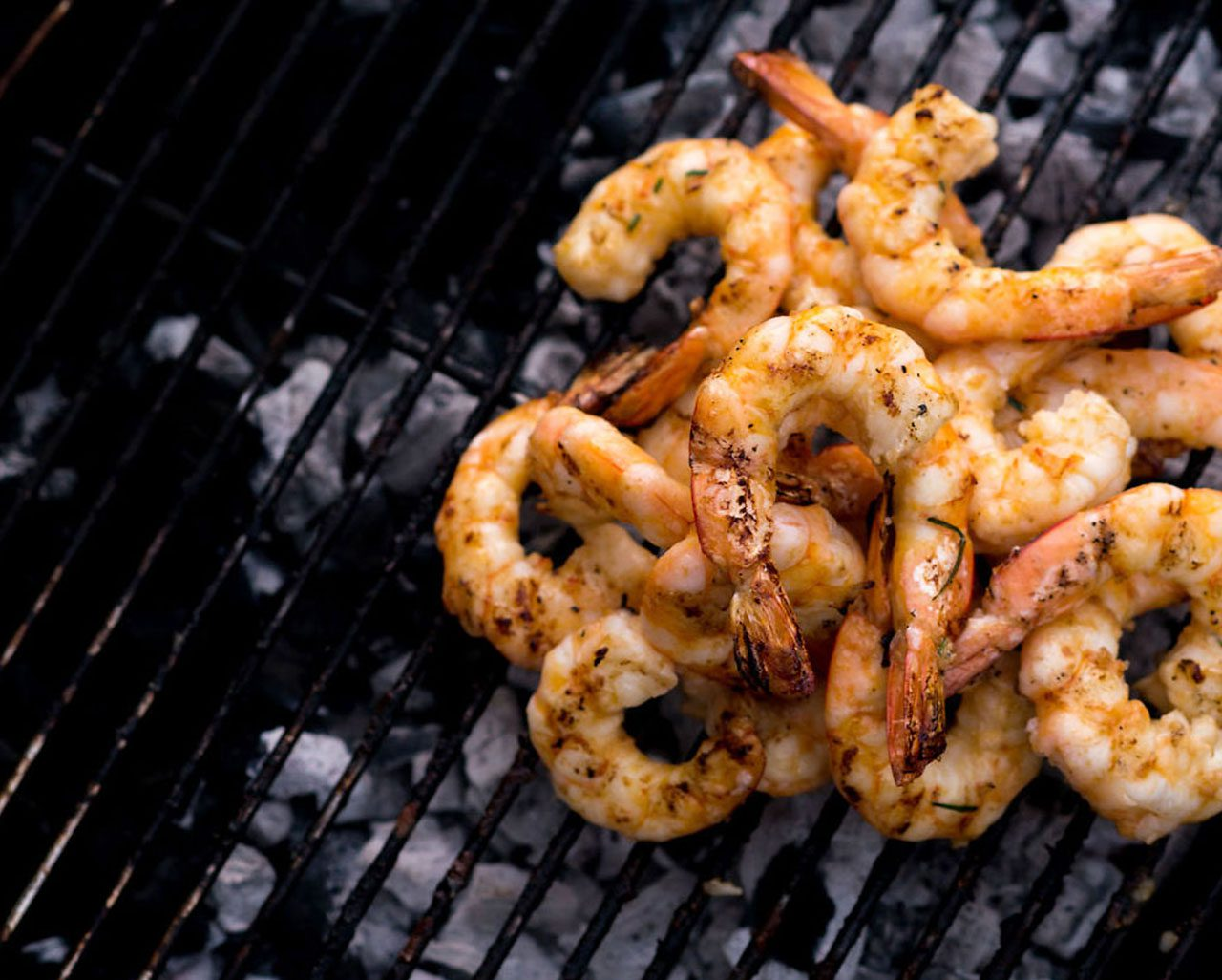 The Marke Apartments Outdoor Kitchen Grilling Shrimp
